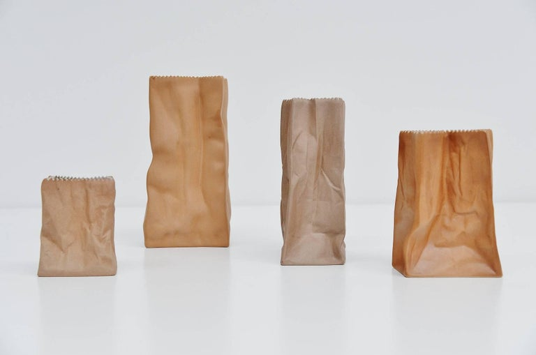 Very nice set of four paper bag vases designed by Tapio Wirkkala and manufactured by Rosenthal, Germany, 1977. These vases are made of porcelain (stoneware) and look like a paper bag. The vases are made in the pop art period and these are very
