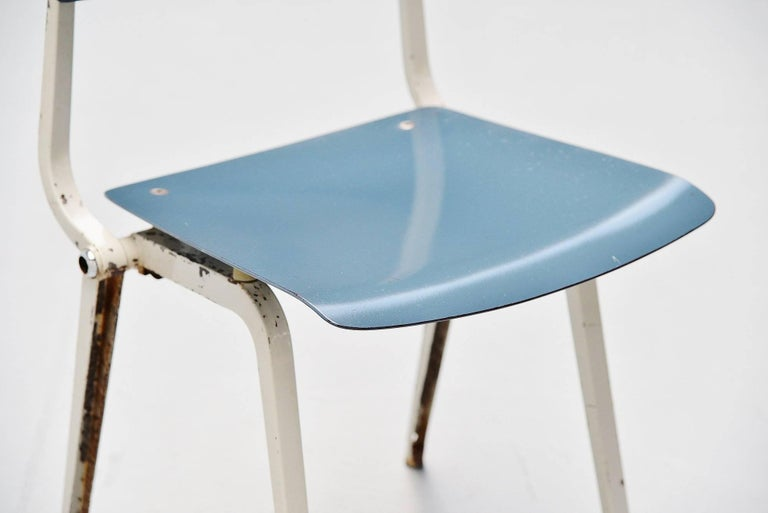 Rare Revolt folding chair designed by Friso Kramer for Ahrend de Cirkel, Holland 1953. Though the Revolt chair was already designed in 1953, the production started in 1958. The chair has a folded metal base which was very strong and a blue ciranol