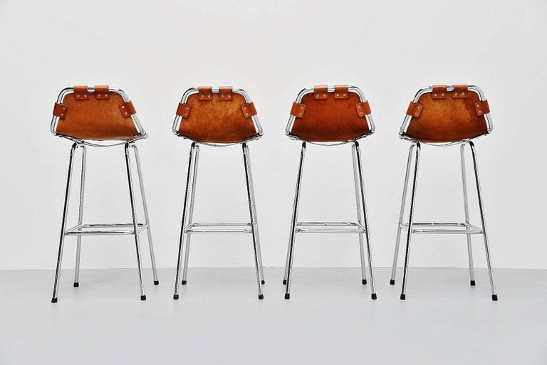 Stunning set of bar stools used by Charlotte Perriand for Les Arcs ski resort, France 1960. The stools have chrome-plated tubular metal frames and thick natural leather seats with amazing patina. These four stools are one of the best I had in years,