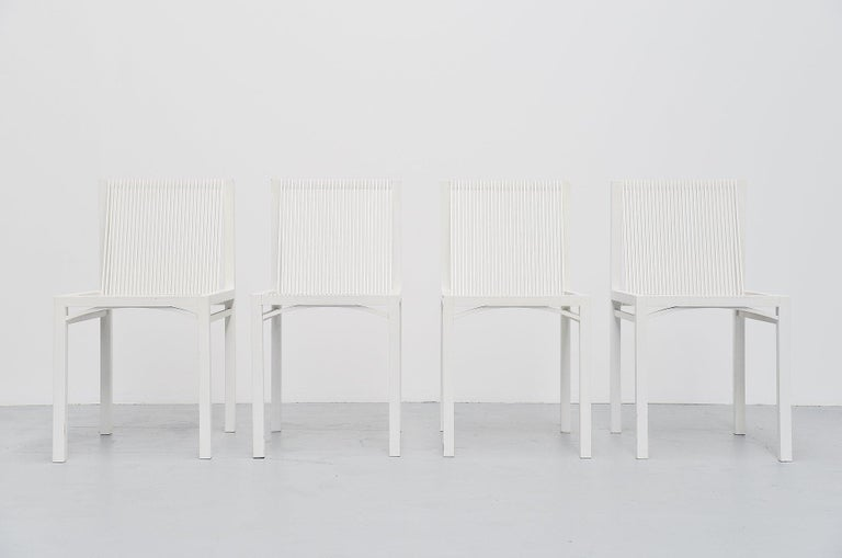 Very nice dining set of 4 dining chairs designed by Ruud Jan Kokke and manufactured by Metaform, Holland 1984. The chairs are made of white lacquered birch wooden slats, glued and joint without screws or nails. The chairs have a very nice structural