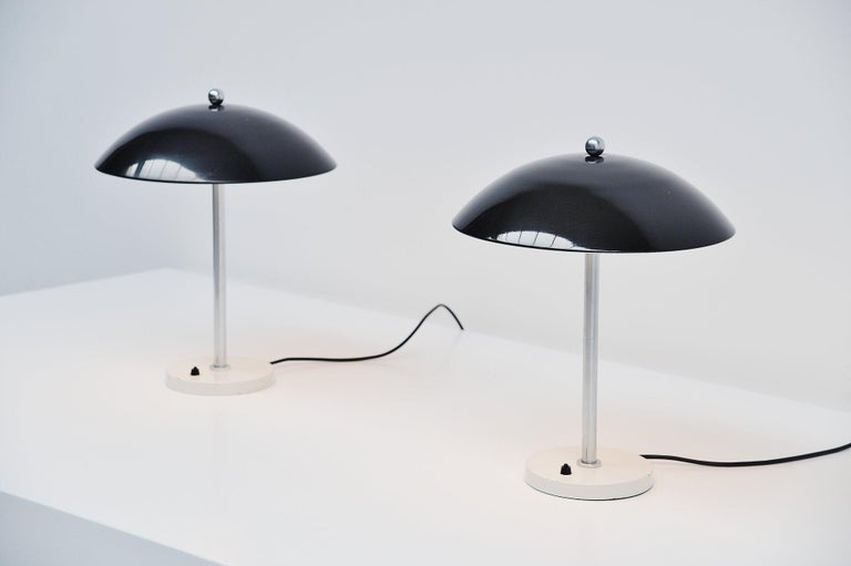 Very nice mushroom shaped table lamp pair model 5015 designed by Wim Rietveld and manufactured by Gispen Culemborg, Holland 1950. These lamps have a round weighted base, white lacquered with a brushed steel bar, use 2 E27 bulbs up to 60 watt each