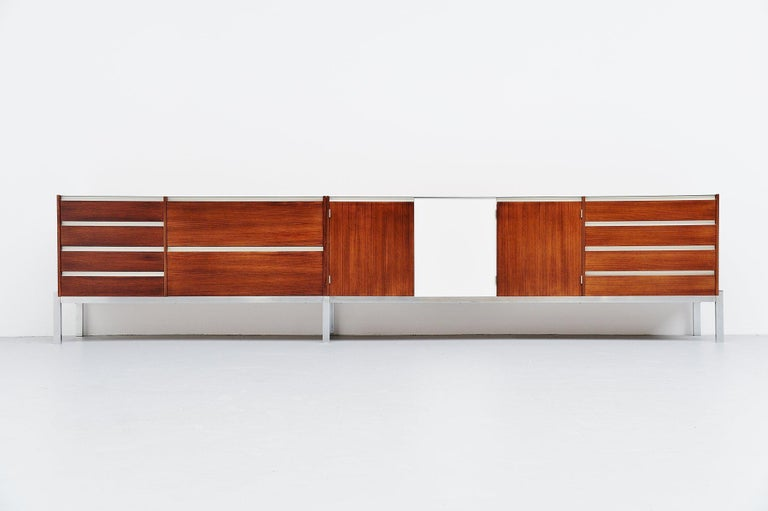 Rare custom made super long sideboard from the J-Series model JDL 255 which was designed by Kho Liang Ie & Wim Crouwel and manufactured by Fristho, Franeker 1957. This fantastic rosewood sideboard has nice details, matt chrome plated metal frame,