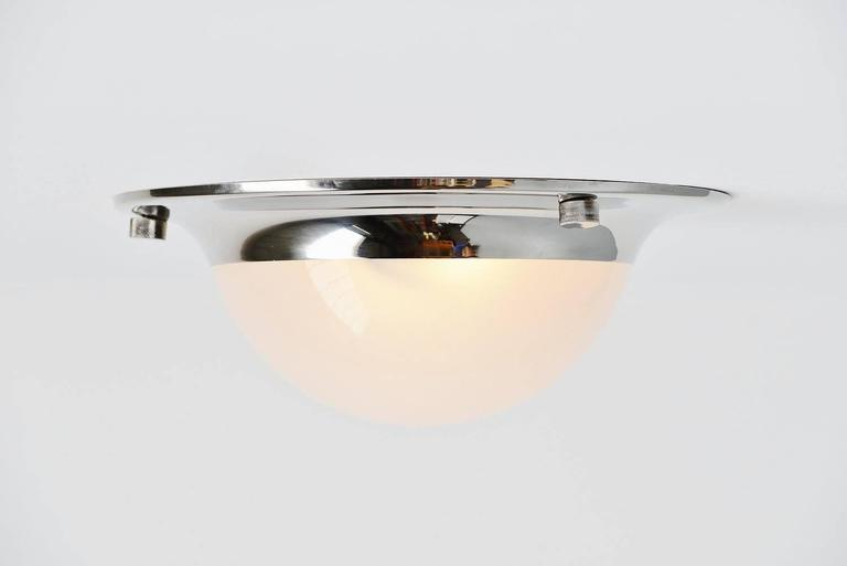 Nice ceiling or wall lamp model (Tommy) LSP6 designed by Luigi Caccia Dominioni for Azucena, Italy, 1965. This is for a lamp that can be used as flush mount ceiling lamp or wall lamp. The lamp has a chrome plated metal structure and glass frosted