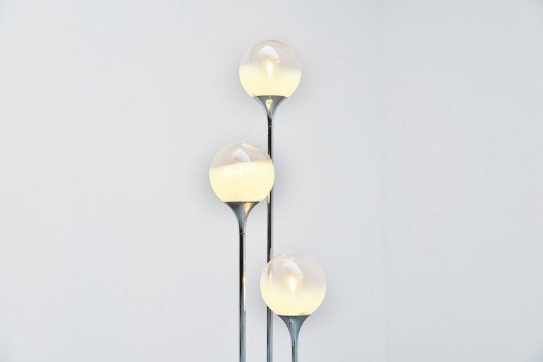Highly decorative floor lamp designed and manufactured by Targetti Sankey, Italy, 1960. This lamp has a white lacquered metal round base, three chrome arms to support the semi transparent and frosted glass globes that give a very nice light effect