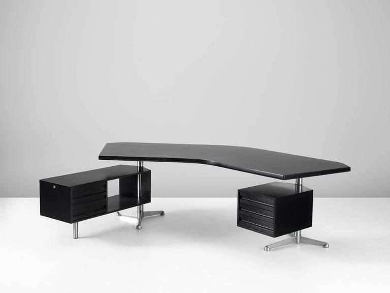 Desk T-96 'Boomerang', in wood and metal, by Osvaldo Borsani for Tecno, Italy 1956.   A very nice black version of this well known design by Osvaldo Borsani. The two revolving cabinets are held in place by the characteristic stainless steel tripods.