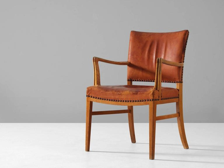 Armchair, in leather and oak, Denmark, 1940s. 