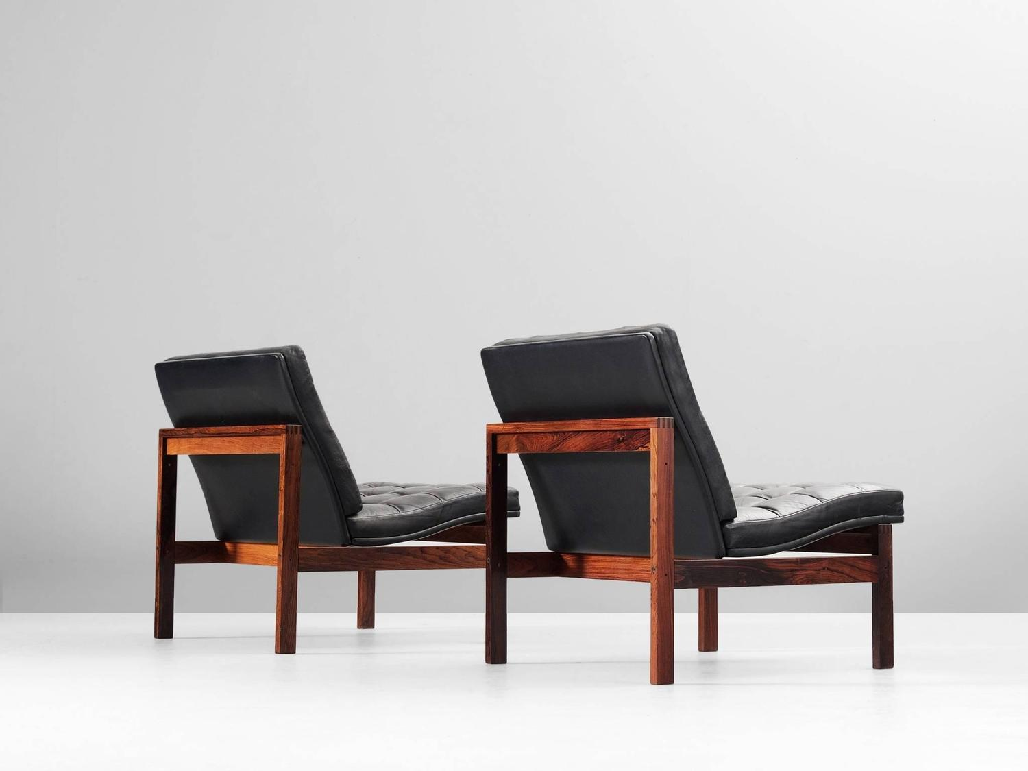 pair of easy chairs in black leather for france and s n for sale at