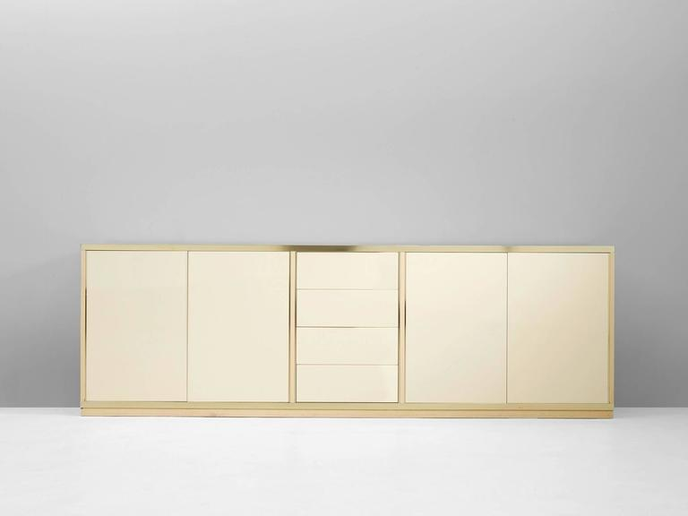 Sideboard, in lacquered wood and brass, Italy 1970s. 