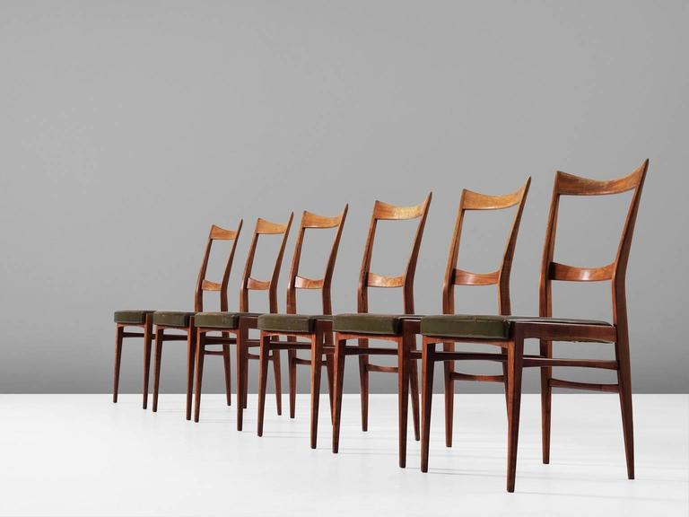 Set of six dining chairs, in walnut and leather, Italy, 1940s. 