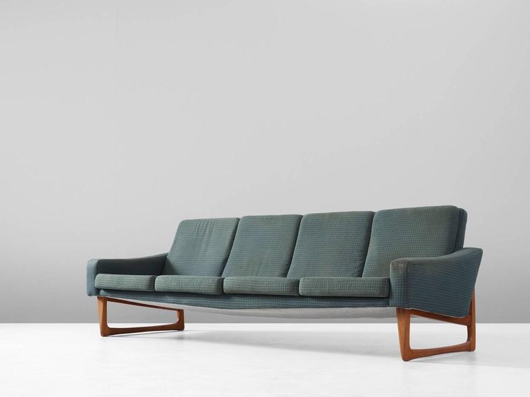 Four-seat sofa, in teak and fabric, Scandinavia, 1960s.