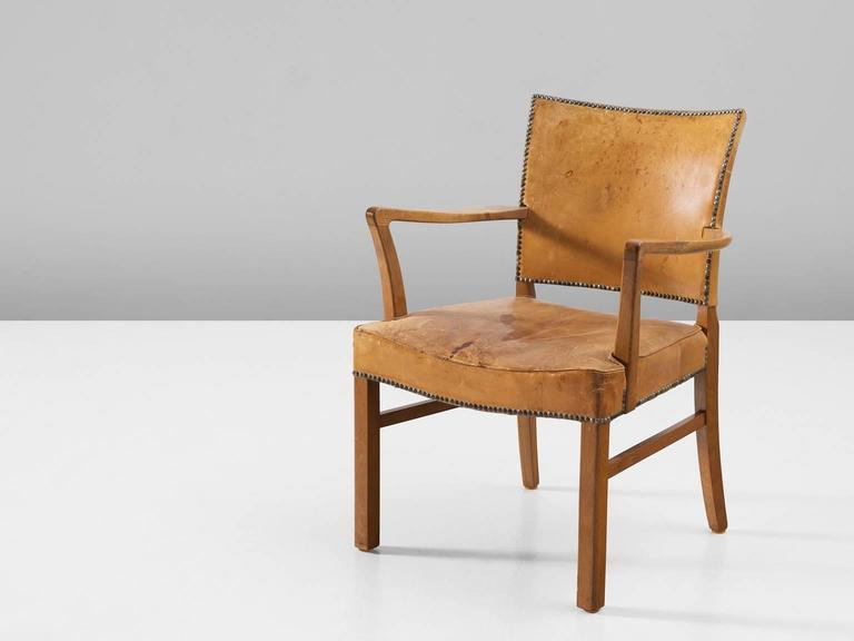 Armchair, in leather and oak, Denmark, 1950s. 