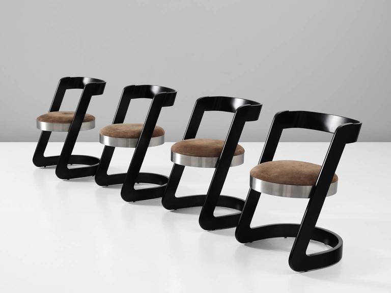 Set of four dining chairs, in wood, metal and upholstery, by Willy Rizzo for Mario Sabot, Italy 1970s.   Set of four cantilevered chairs in black lacquered bentwood. These chairs have a round base of brushed metal. The frame consist of two