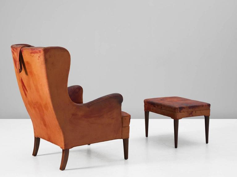 Danish Frits Henningsen Wingback Chair and Ottoman in Original Cognac Leather For Sale