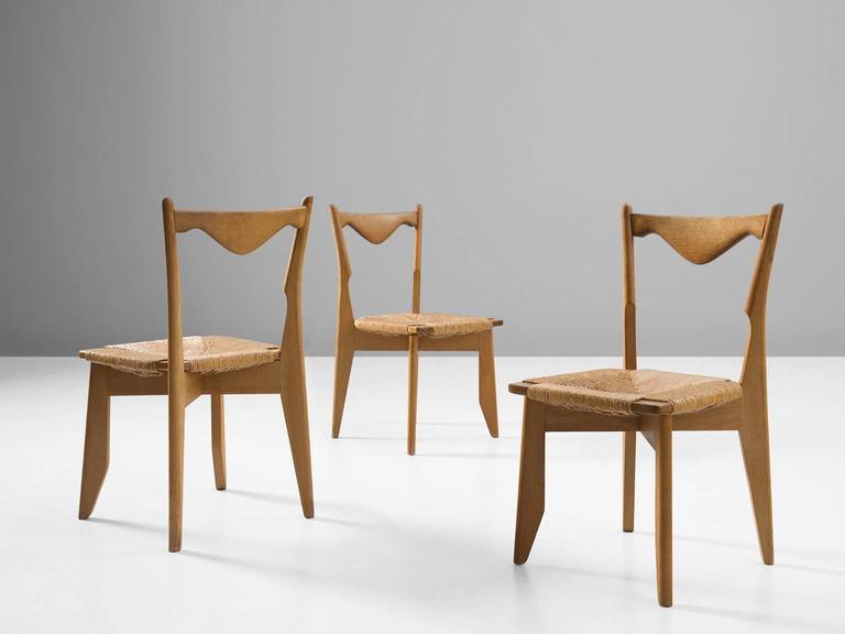 French Guillerme & Chambron Set of Six Dining Chairs in Oak and Woven Seating For Sale
