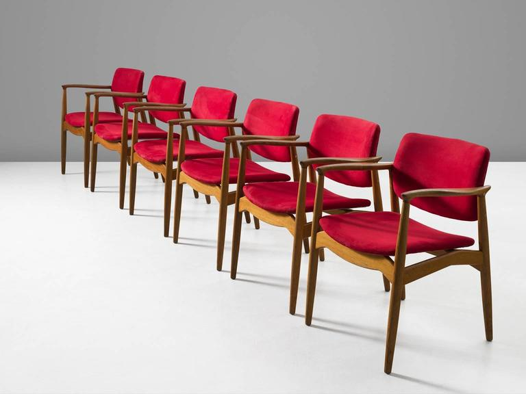 Set of six 'Captains' armchairs, in oak and faux-leather by Eric Buck for Ørum Møbler, Denmark, 1957.   Set of six sculpted dining chairs in solid oak. These chairs show the characteristics of the well-known model 50 by Erik Buck. Yet this model