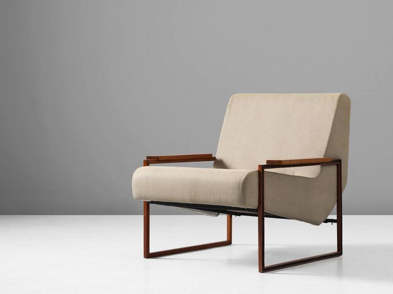 Lounge chair, in metal mahogany and fabric, by Percival Lafer, Brazil 1960s.   Modern armchair by Brazilian designer Percival Lafer. This chair shows stunning lines. The frame is made of two metal squares with mahogany wood. Seating and back show