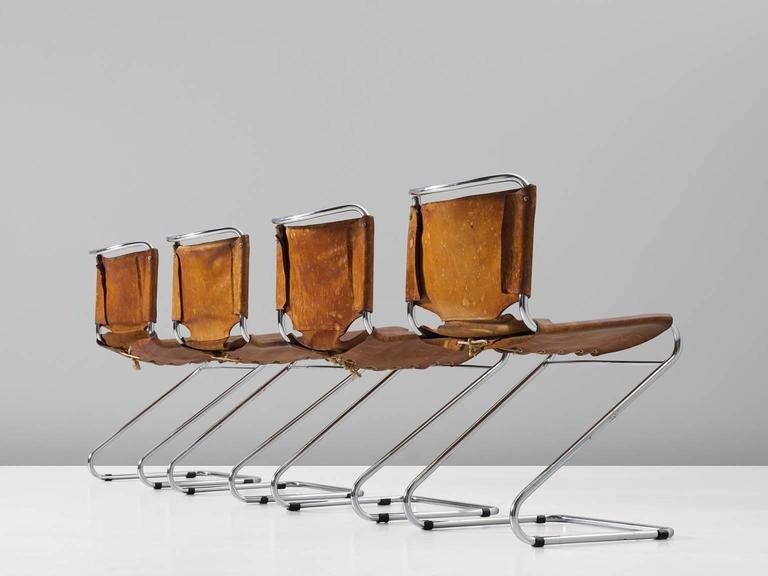 European Set of Four Tubular Dining Chairs with Patinated Cognac Leather Upholstery
