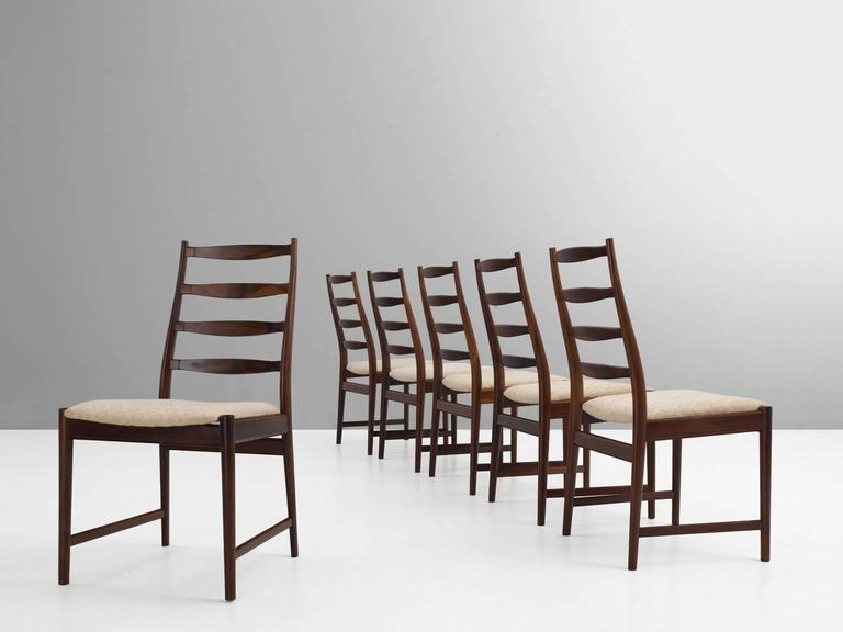 Set of six dining room chairs, in rosewood and fabric by Torbjørn Afdal for Vamo Sonderborg, Norway, 1960s. 