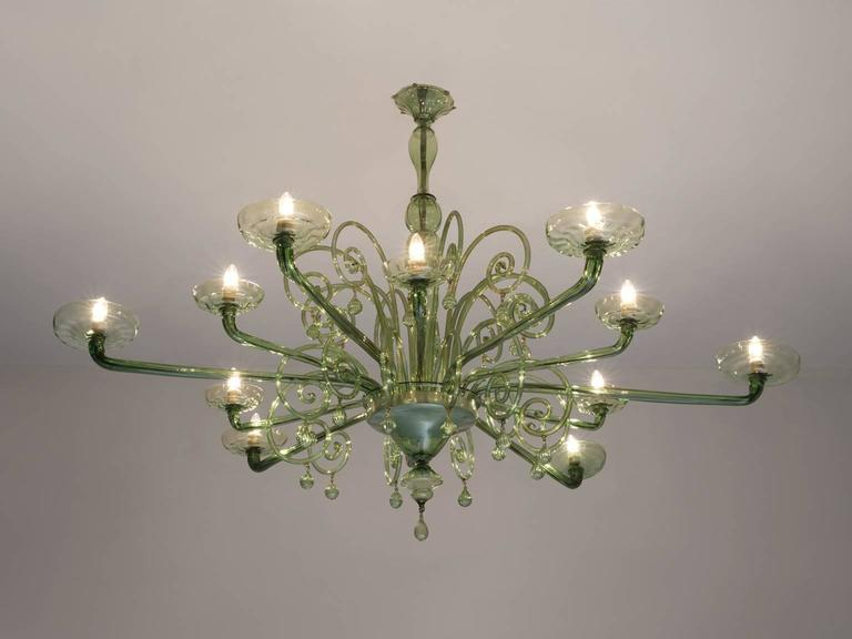 Venini Chandelier, Murano glass and metal, 1930s, Venice, Italy.   This large Murano glass chandelier has six large arms and six smaller arms which create a stunning light-partition. The chandelier is attributed to Napoleone Martinuzzi for Venini.