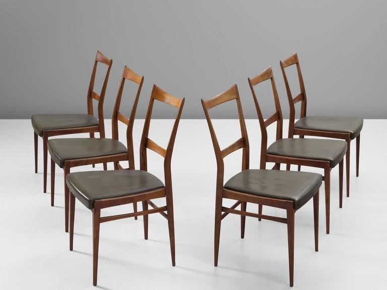 Six chairs, leather and walnut, Scandinavia, 1950s.