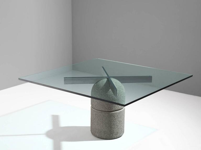 'Paracarro' dining table, in concrete, metal and glass, by Giovanni Offredi for Saporiti, Italy, 1973.   This strong and sturdy concrete, steel and glass table by Giovanni Offredi is exemplary for the postmodern design of the postwar Italian era.