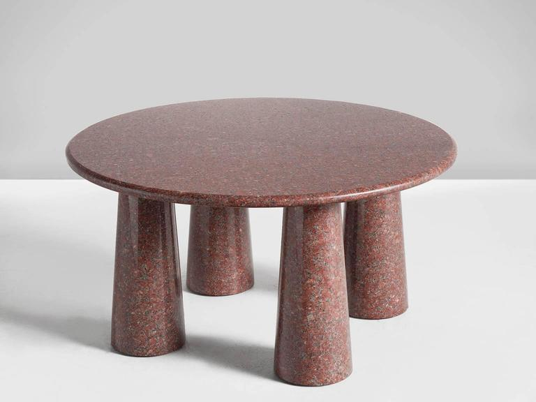 Circular red cocktail table, granite, 1970s, Italy  This small but solid table has a strong architectural features such as cone shaped legs. The circular top is small in comparison to the legs, giving this table a dense and strong look despite its