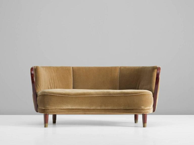 Three-seat sofa, beige to sand upholstery, wood, brass, Manufactured by Bramin, N. A. Jørgensens Møbelfabrik, Denmark, 1950s.  This Danish sofa features a backrest that is divided into three sections. The seat is thick and features a delicate