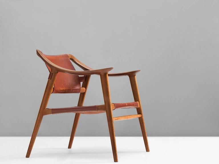 Armchair model 56/2 'Bambi', in teak and leather, by Rolf Rastad & Adolf Relling for Gustav Bahus, Norway, circa 1954.   Excellent example of the 'Bambi' chair of Rolf Rastad and Adolf Reling. This edition consist of a teak frame and cognac