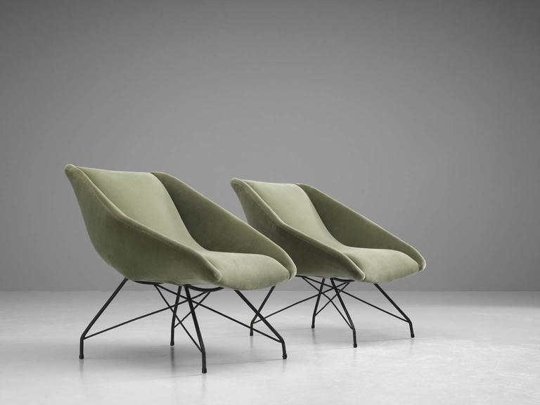 Pair of armchairs, in iron and green velvet fabric, by Carlo Hauner  for Forma, Brazil, 1950s.   Elegant and modern armchairs by Brazilian designer Carlo Hauner. The thin, elegant frame is made from black painted iron. Due the diagonal connection
