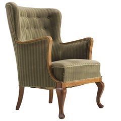 Danish Saber Leg Wingback Chair in Green Upholstery