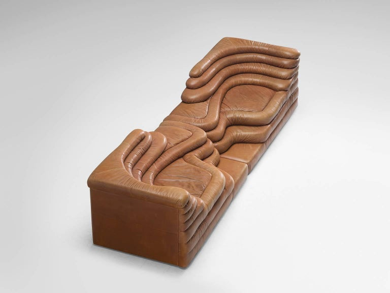 Pair of DS1025 'Terrazza' landscape elements, in cognac leather, by Ubald Klug for De Sede, Switzerland, 1970s.   Waterfall shaped sofa in cognac leather by the Swiss manufacturer De Sede. The leather is in outstandingly good patinated condition.