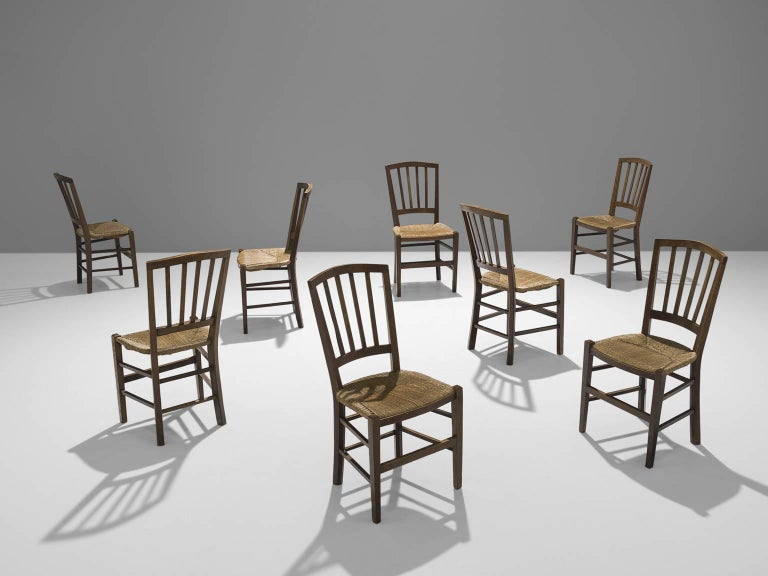 Large set of chairs, oak and rope, The Netherlands, 1960.  These eight stately chairs are executed in rope and patinated oak. The chairs have a solid and geometric backrest. The chairs are both functional and clear in their design. The design is
