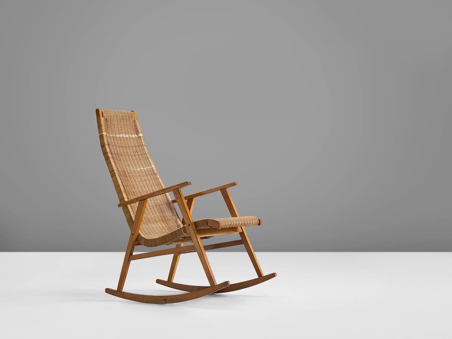 Lounge Chair, In Cane And Wood, The Netherlands, 1950s. This Classic Rocking