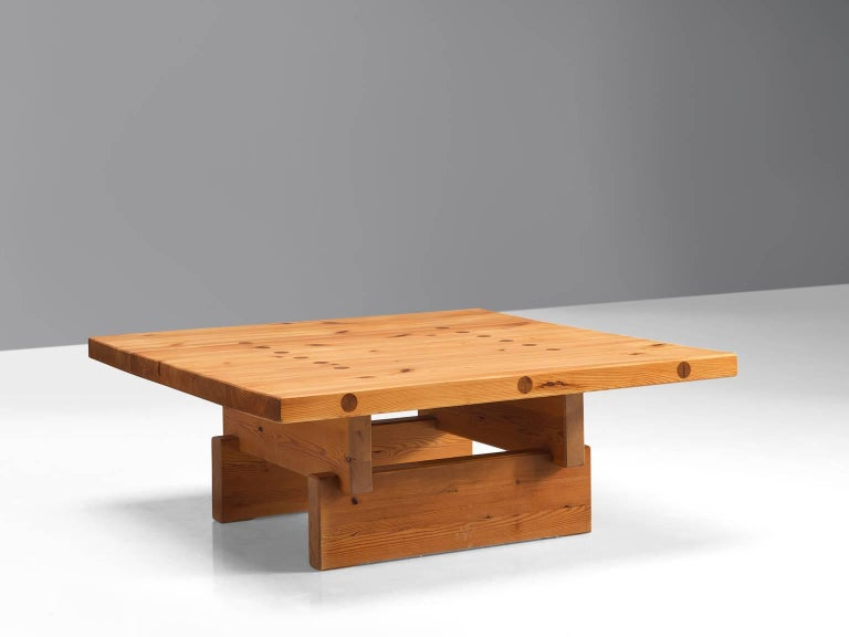 Roland Wilhelmsson for Karl Andersson & Söner, coffee table, top and frame with visible joints, Denmark, 1960s   This remarkable solid and sturdy table holds a strong expression due to its build up with solid, horizontal and vertical planks. This