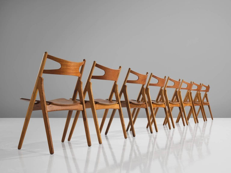 Hans J. Wegner for Carl Hansen & Søn, set of eight 'Sawbuck' CH29 chairs, oak, teak, Denmark, 1952.  This set of eight chairs is designed by Hans J. Wegner for Carl Hansen. This chair holds a very strong construction even though it has a simplistic