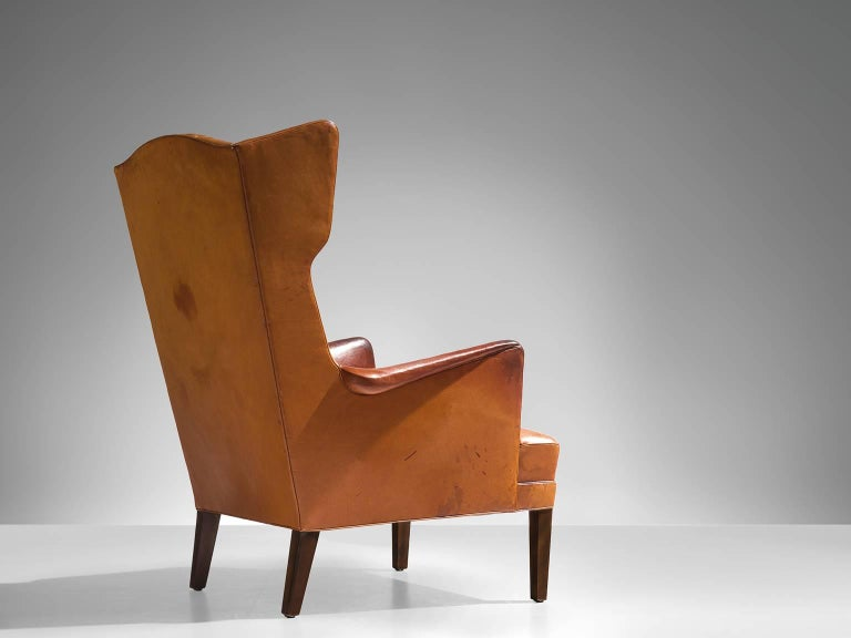Danish Frits Henningsen Cognac Wingback Easy Chair For Sale