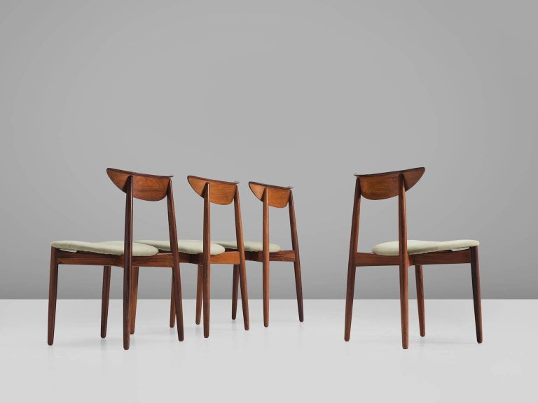 Harry Østergaard, set of four chairs, in rosewood and fabric, Denmark, 1950s. 