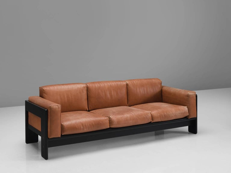 Tobia Scarpa for Knoll, 'Bastiano' sofas, leather, wood, Italy, design 1962, later production.  This pair of Bastiano sofas is designed by Tobia Scarpa in 1962. The three seaters features thick brick red leather and a stained dark wooden basket
