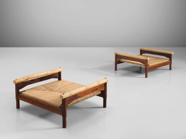 Benches or stools, rosewood, cane, bamboo, Italy, 1960s.  These midcentury stools are made of rosewood, cane and bamboo are very sculptural and robust. Their design is as such that it is very low to the ground. The materials are warm and natural and