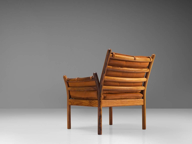 Illum Wikkelsø by CFC Silkeborg, 'Genius' chair, leather and rosewood, Denmark, 1950s.  This chair is made out of solid rosewood and features a cognac leather cushion on both seat and back.. The chair is created as a sort of slatted rosewood basket.