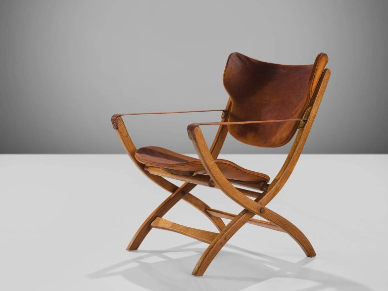 Poul Hundevad, 'Egyptian' chairs, cognac leather, beech and birch, Denmark, 1950s.   This side chair is part of the midcentury design collection. This folding chair has X- shaped legs that are inspired on ancient Egyptian thrones and chairs. The