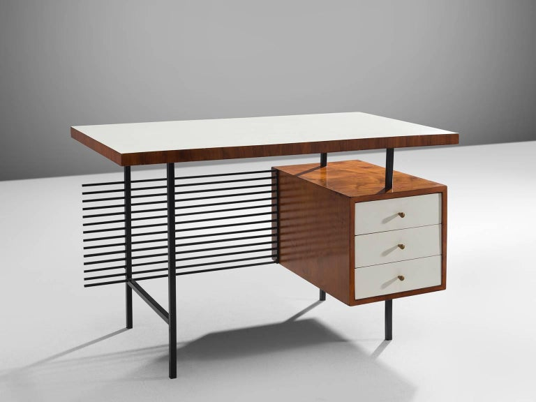 Geraldo de Barros, desk, white formica, rosewood metal, Brazil, 1950s.  This delicate desk is by designed by the Brazilian modernist designer Geraldo de Barros. The most distinct part of this desk is the back were a display of black metal rods are