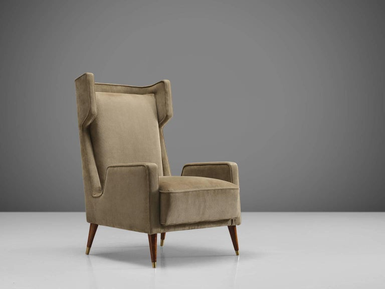 Giuseppi Scapinelli, lounge chair in caviuna wood and beige curduroy, 1950s, Brazil.  Elegant easy chair with upholstered shell. The sculptural back combined with the sensuous curved armrests and diagonal tapered legs are both geometric and stately