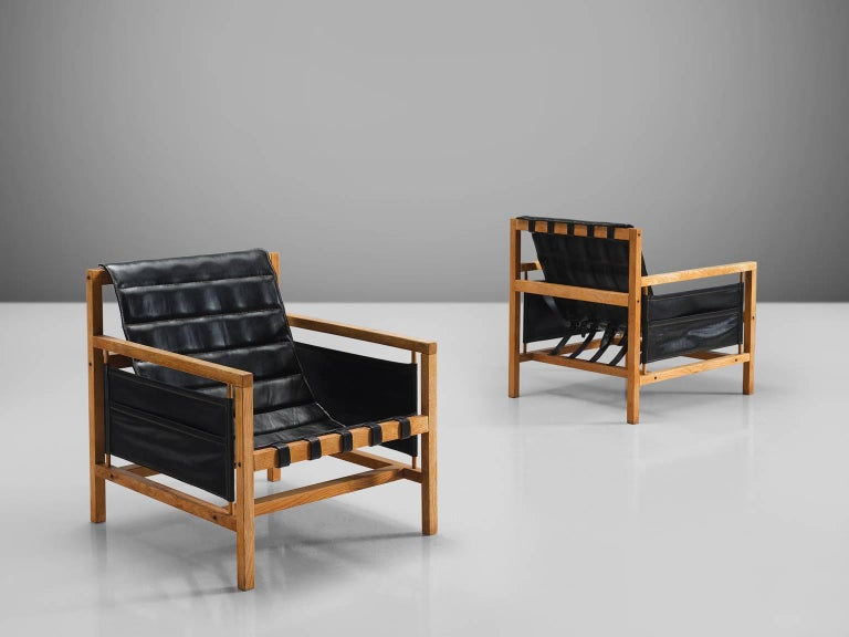 Mogens Plum and Kay Ingemann Iversen for Poul Hundevad, 'PH81', beech, black leather, Denmark, circa 1965  This set of comfortable Danish armchairs are designed by Plum Mogens and Kay Ingemann Iversen. The chairs are executed black leather and beech
