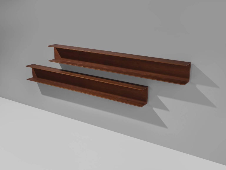 Walter Wirz for Wilhelm Renz, wall shelves, teak, Germany, design 1965, production 1960s  This solid teak wall shelf is designed by Walter Wirz for the German company Wilhelm Renz. The shelf, by now a true midcentury design classic, is both well