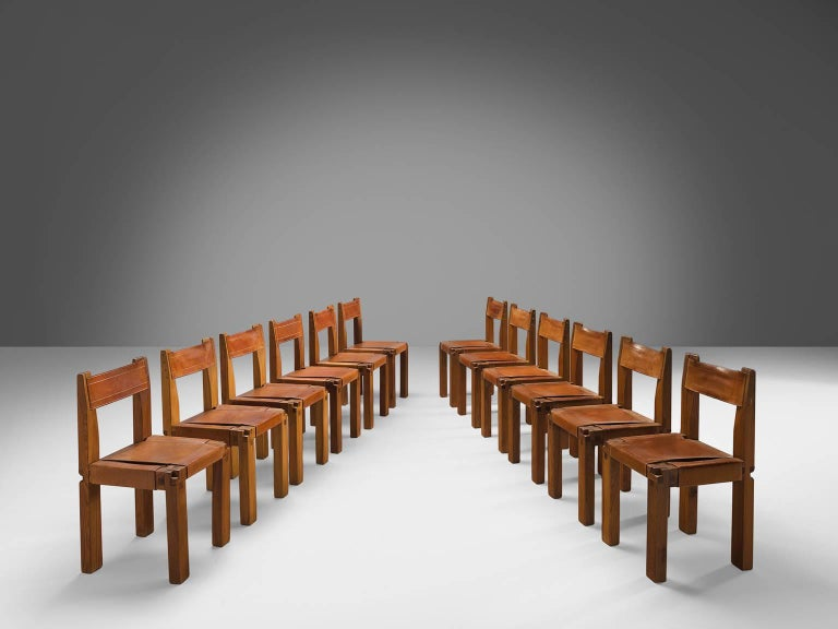Pierre Chapo, set of 12 dining chairs, model S11, in elm and leather by France, ca. 1966.  Large set of 12 chairs in solid elmwood with saddle leather seating and back. Designed by French designer Pierre Chapo in Paris. These chairs have a cubic