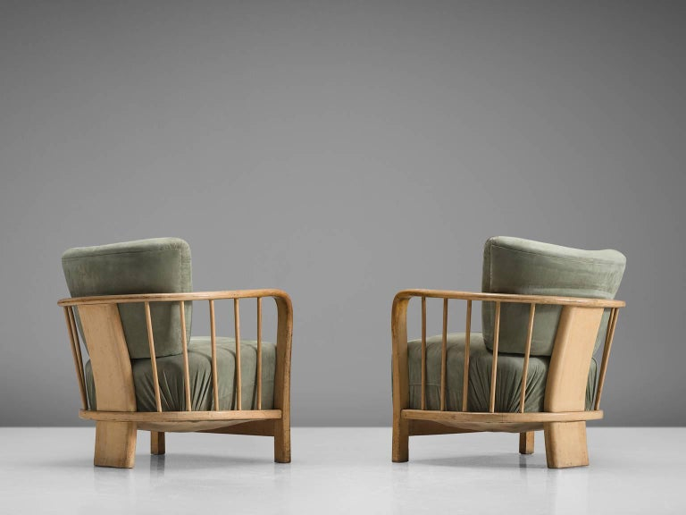 Lounge chairs in ash and olive green fabric, Western-Europe, 1960s  This set has a very sculptural, open frame. The three thick, sturdy legs hold the slatted baskets and have a robust, geometric shape. The chairs are strong in their design and