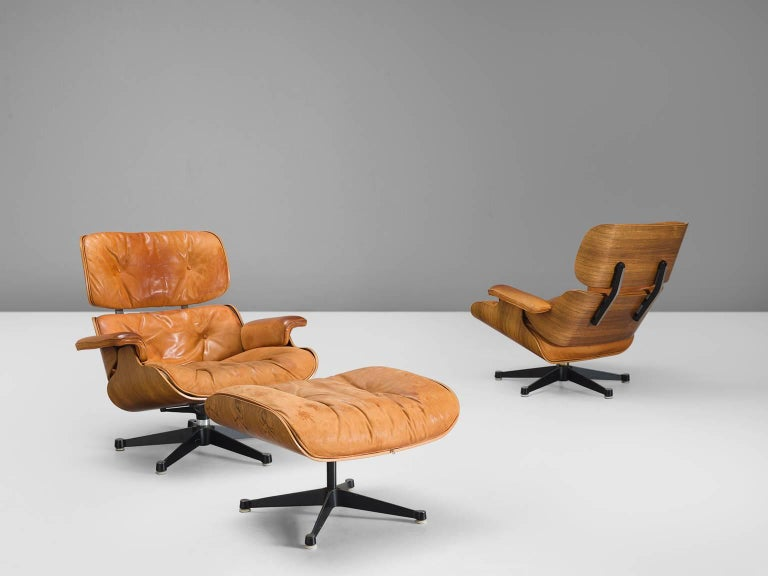 Charles and Ray Eames, lounge chairs and ottoman, leather and rosewood, United States, 1956 design, 1960s production.  This iconic set by Charles and Ray Eames has been came into existence over the course of 13 years. This chair is their modernist