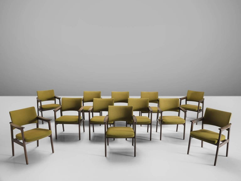 Set of twelve dining chairs in oak and olive green upholstery, Scandinavia, 1960s.   These solidly constructed stained oak chairs show elegant lines and a solid construction. This set of twelve feature a high back and show craftsmanship at its best.