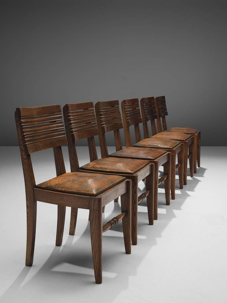 Mid-Century Modern Gaston Poisson Set of Six Leather and Oak Dining Chairs For Sale